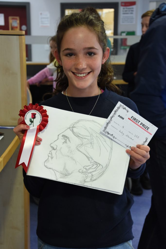 Lily Glover with her first prize winning drawing.