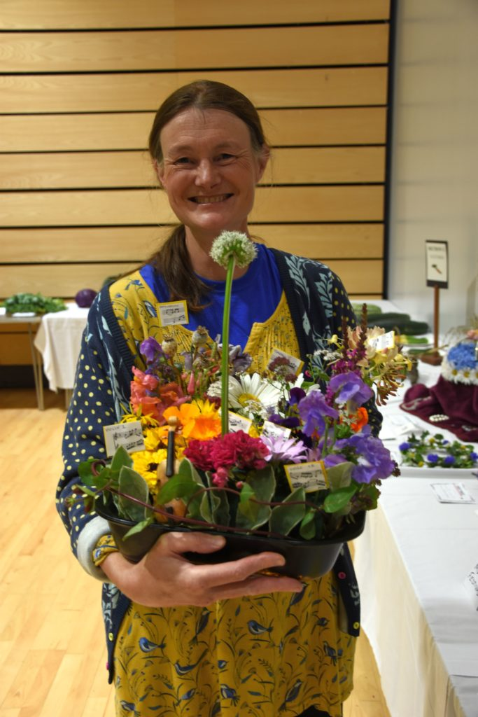 Alice Maxwell with a flower arrangement which earned her the Allen McKay Memorial Quaich.