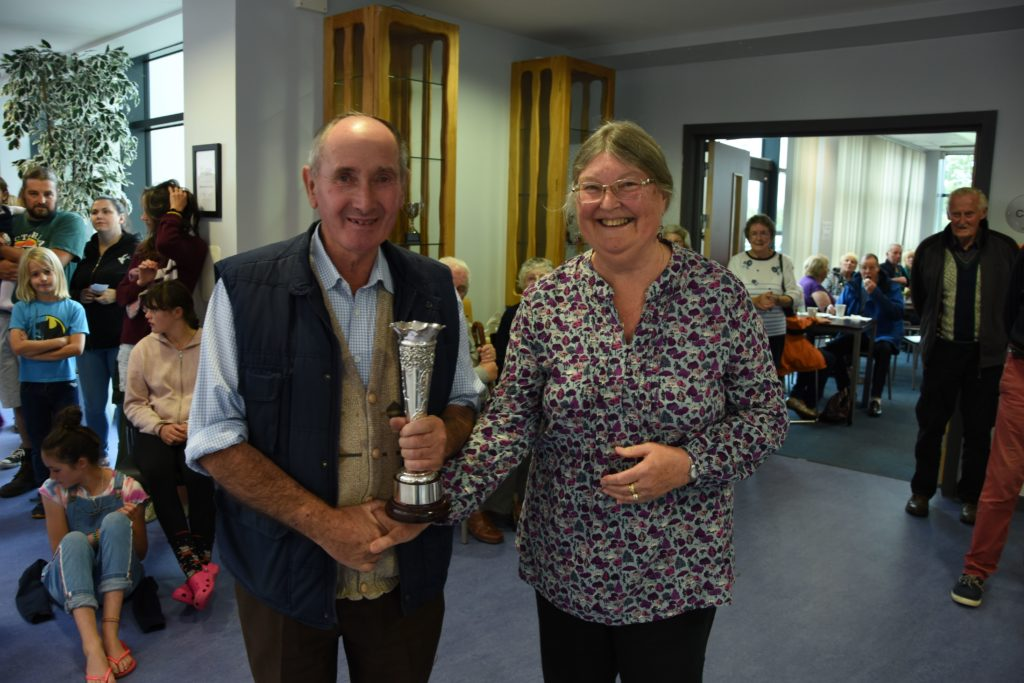 Angela Cassels presents Charles Hendry with the Mrs Blain Silver Vase for his display of roses.
