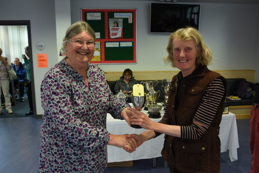 Angela Cassels presents Janice Murray with the Lady Jean Fforde Cup for the best exhibit in the pot plant section.