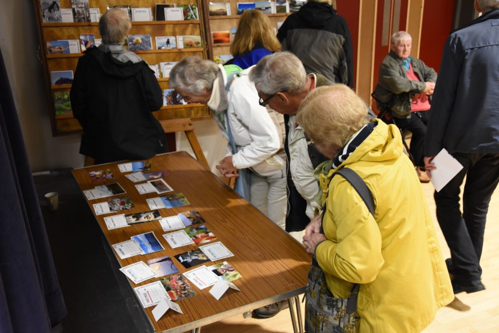 Visitors browse the photographic section.