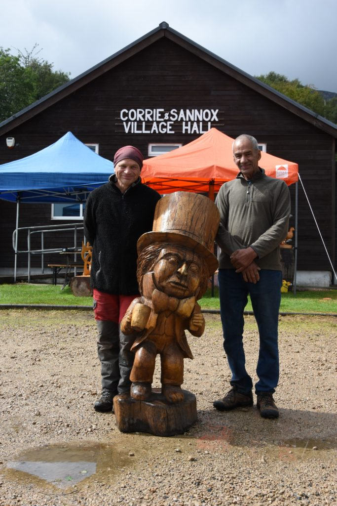 Carvers Marvin Elliott and Robert Coia with one of Robert's large carvings.