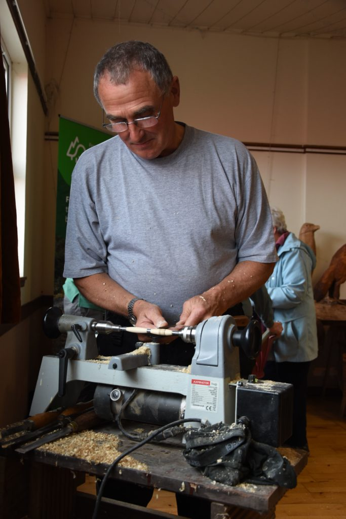 Rory Cowan, more accustomed to boat building, invited visitors to try out his mini lath which is used for small wood turning projects.
