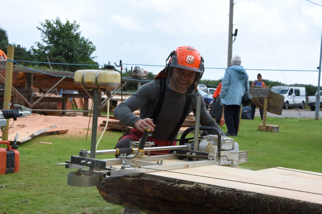 Jamie Campbell demonstrates his Alaskan mill, a mobile chainsaw mill that can be operated by a single person.