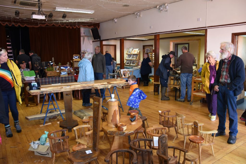 Visitors browse through a number of wooden items on display at the festival.