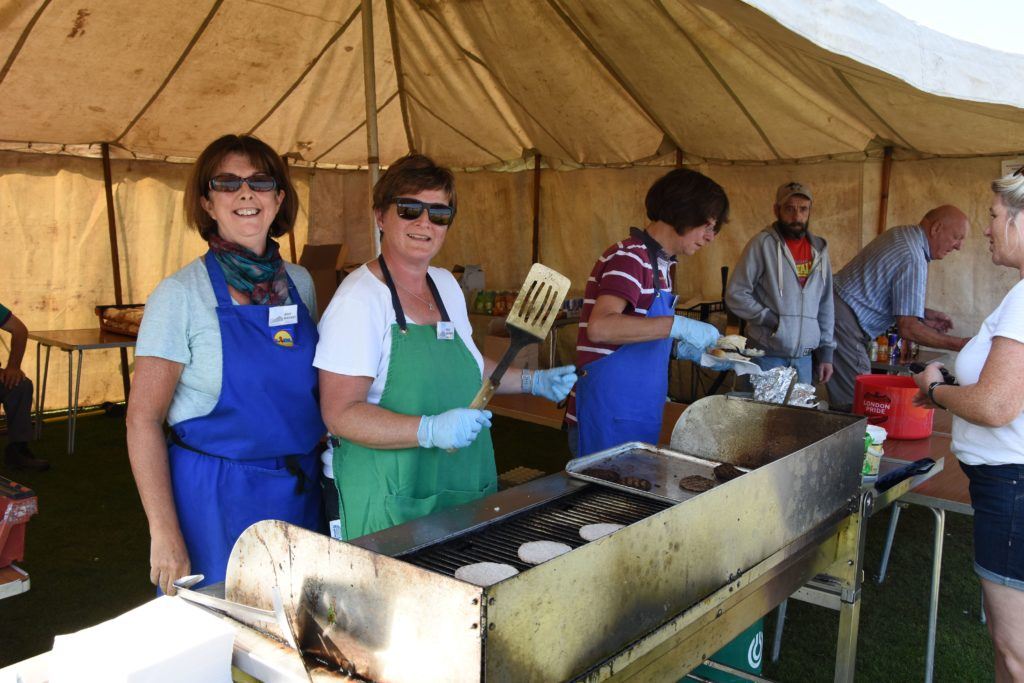 Kathleen Boag and Stacey Smith keep everyone well fed at the burger stall.