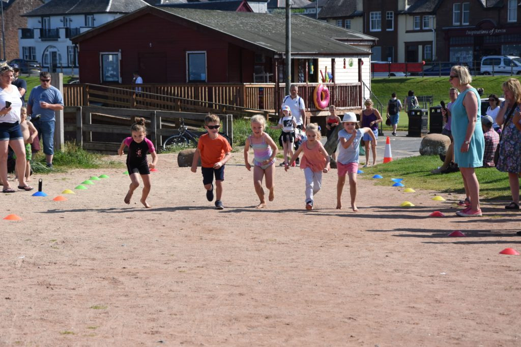 Runners at the ready, children set off in the beach races.