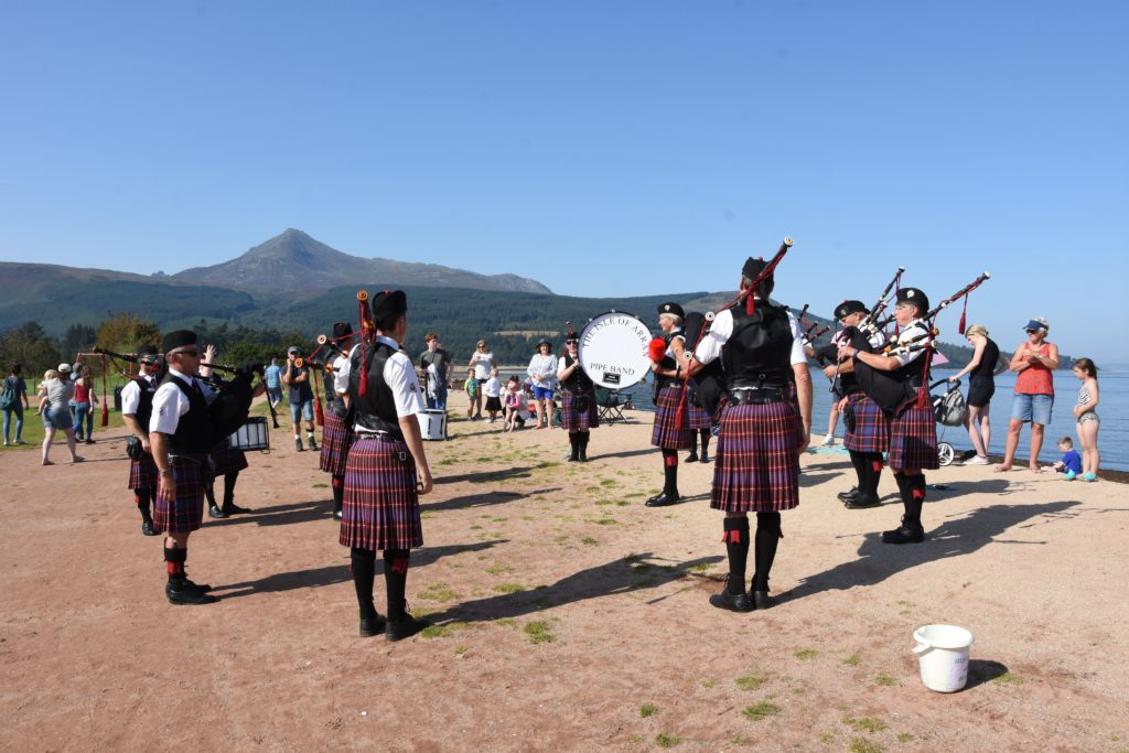 An unusual but well appreciated sight on Brodick beach, The Arran Pipe Band perform at the beach party.