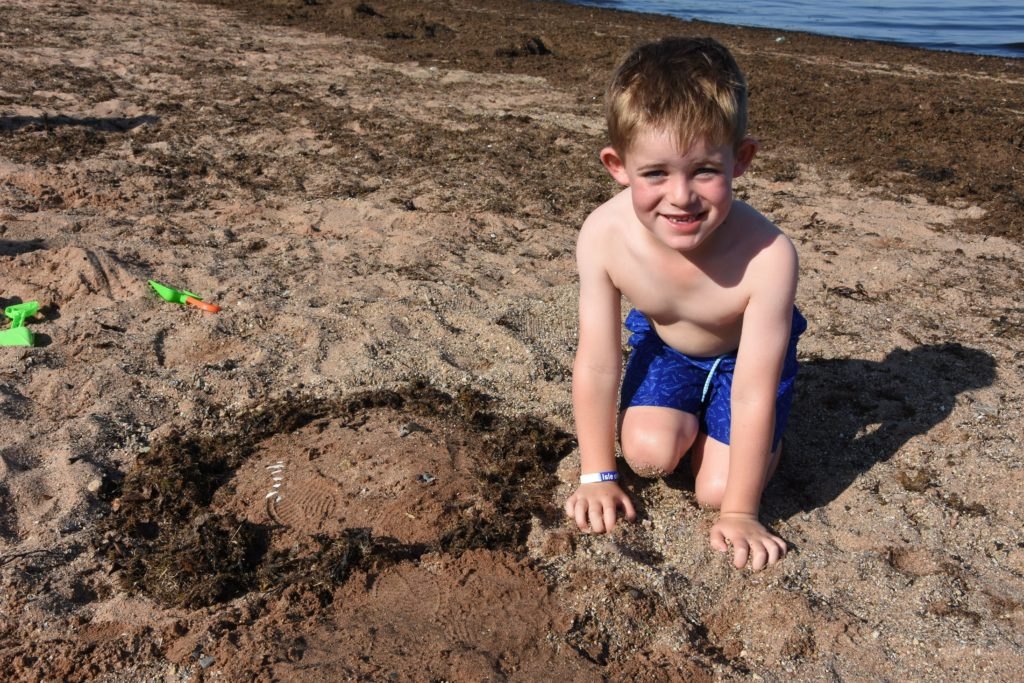 Luca Duncan with his small but perfectly formed beach creation.