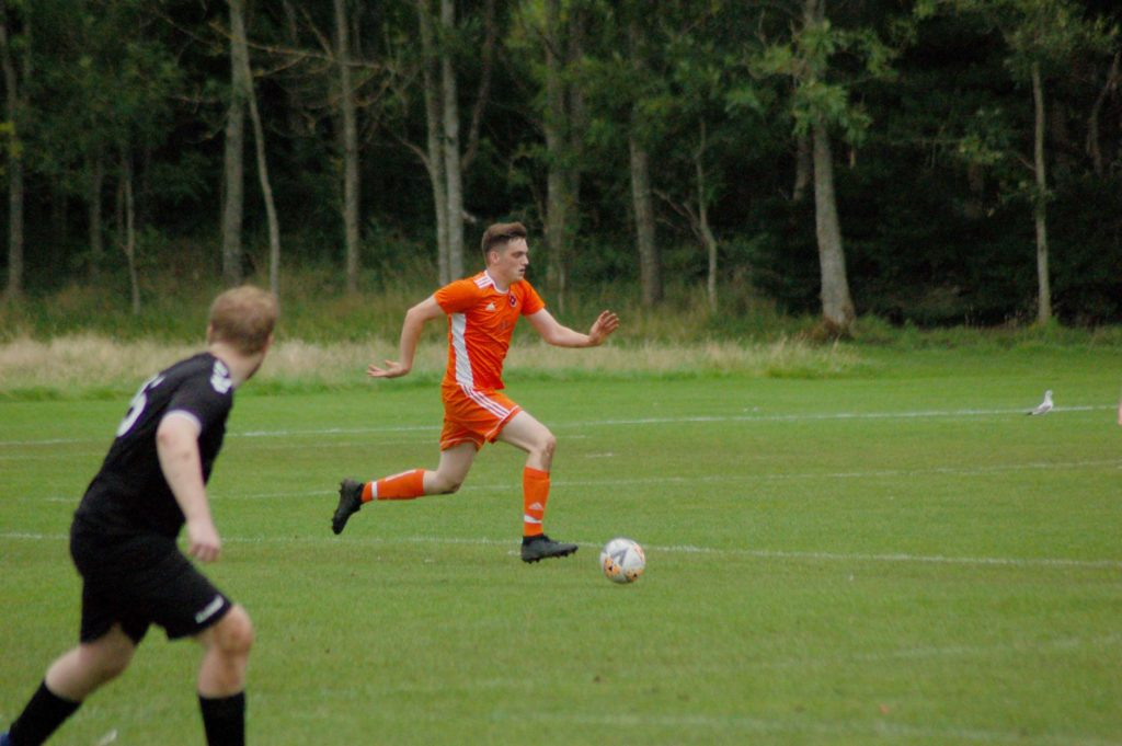 Joel Small powers towards the goals to score for Arran.