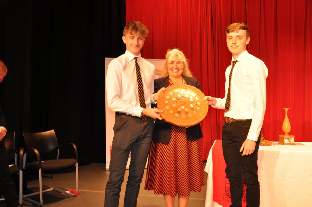 Shurig won the Inter-House Award which house captains James Reid and Charlie Bonner are seen receiving from Laura Cook.