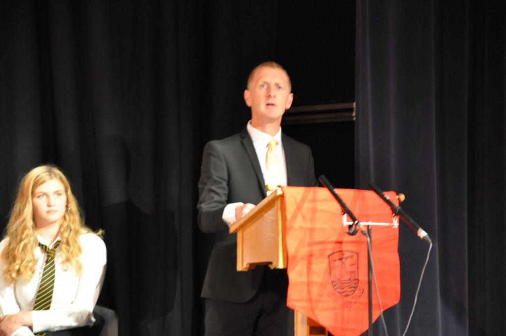 Head teacher Barry Smith addresses the audience.