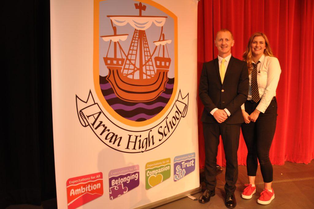 Head teacher Barry Smith and Dux Eilidh Hamill with the Arran High School badge and motos.