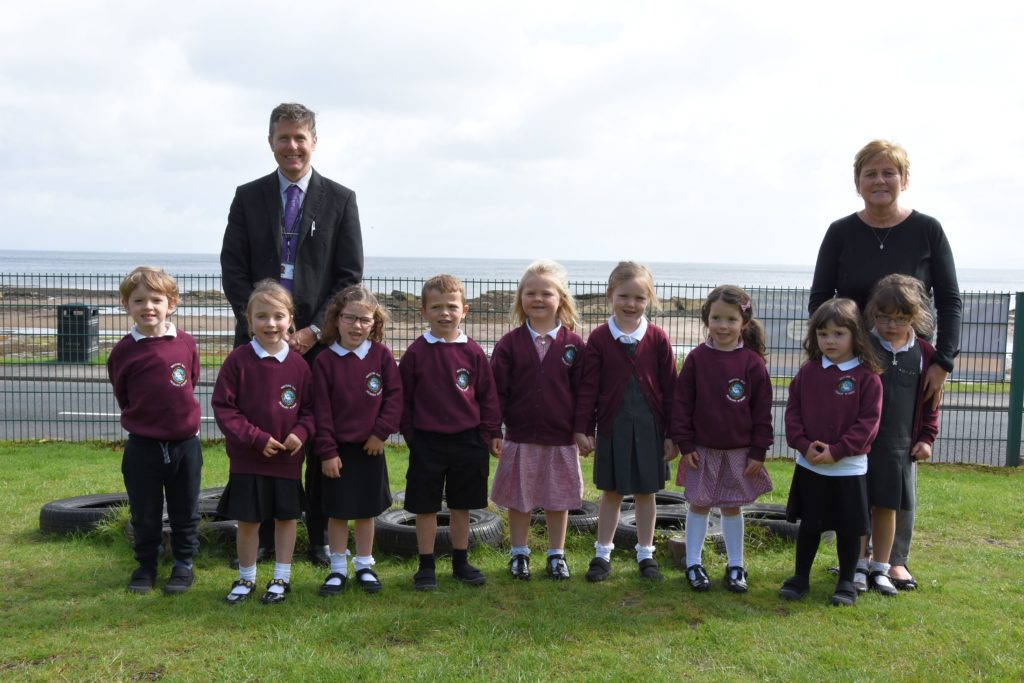 Arran depute head Quinton Black and teacher Sheila MacAlister with their new intake of P1 pupils.