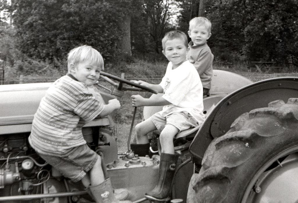 Thomas Duffett and Gavin and Fraser Gilbert test out a 1954 Ferguson TE20 tractor at the 6th annual National Trust Country Fair.