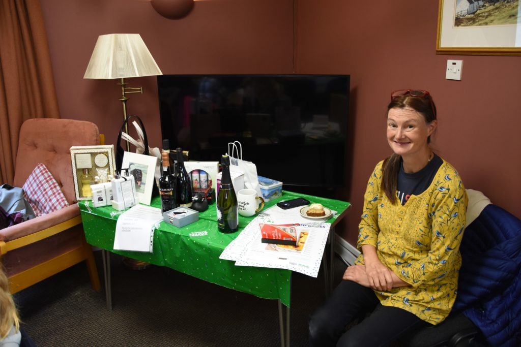 Alice Maxwell of Alice's Wonderland B&B ran the raffle at the Lamlash Macmillan coffee morning.
