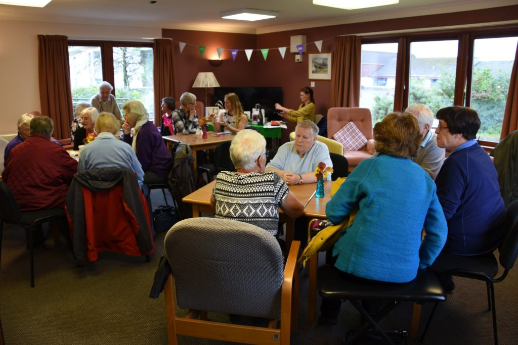 Visitors pack the seating area at the McKelvie Road Retirement Housing complex to enjoy coffee, tea and home baking.