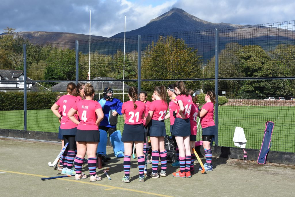 In glorious sunshine Arran players discuss strategy during the half time break.