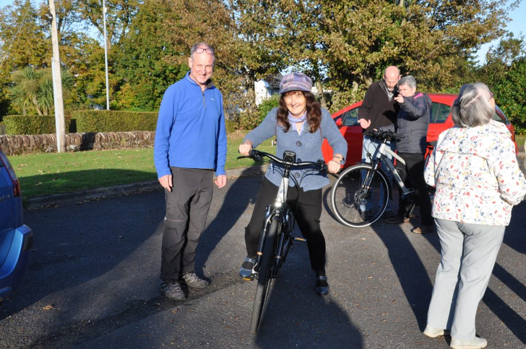 Helen Ross gives an eBike a go under the watchful eye of Andrew Binnie.