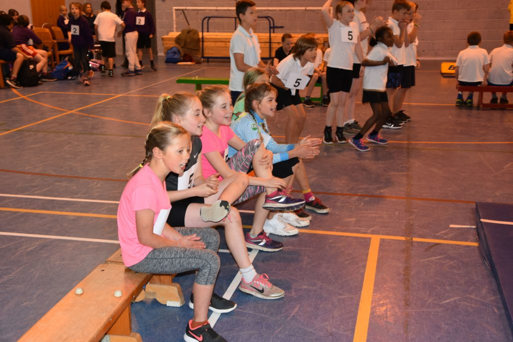 Participating athletes cheer on their friends.