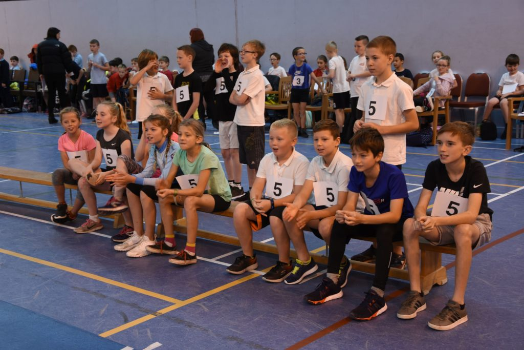 Participants watch the progress of their class mates as they wait for their turn.