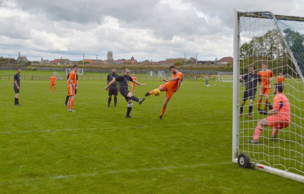 Ryan Armstrong has a go at goal right in front of the Irvine keeper.