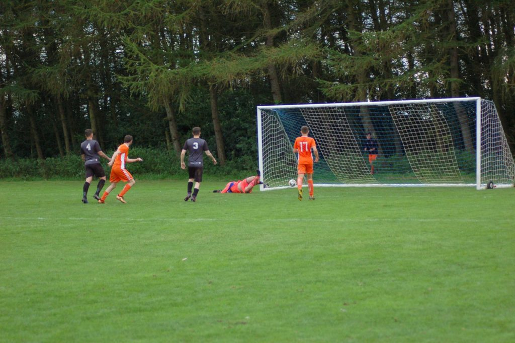 Fleet-footed Archie McNicol outwits the Irvine keeper to score his fourth goal of the game.