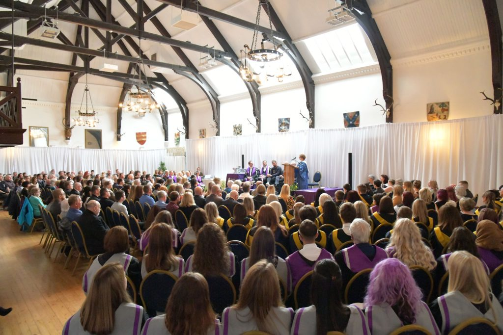 Assembled graduates and guests in the Argyllshire Gathering Halls, Oban.