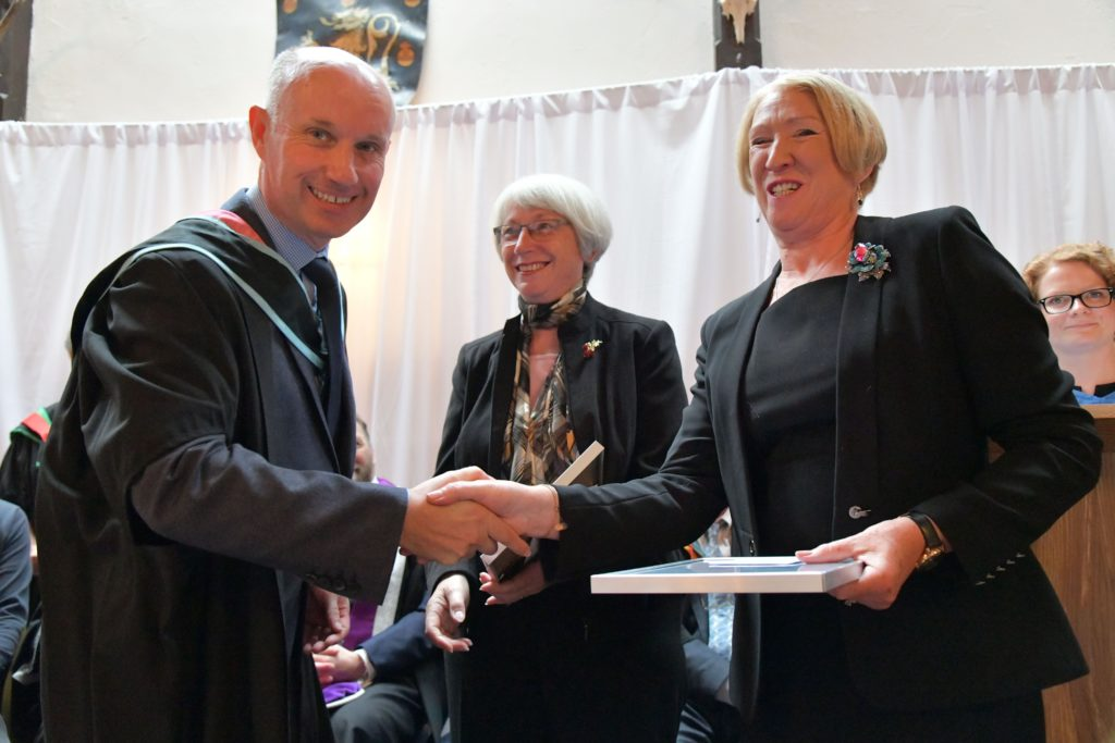 Helen How and Janet Bray receive the SQA Principal's Award from College principal Martin Jones.
