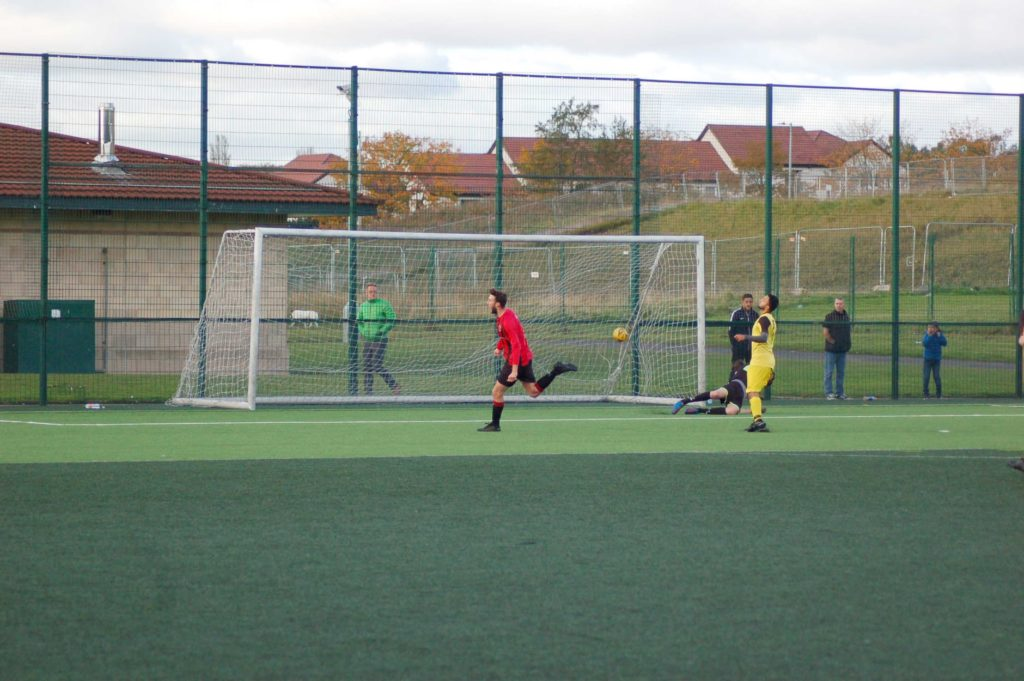 Ryan Armstrong outwits the keeper to land the ball in the corner of the net.