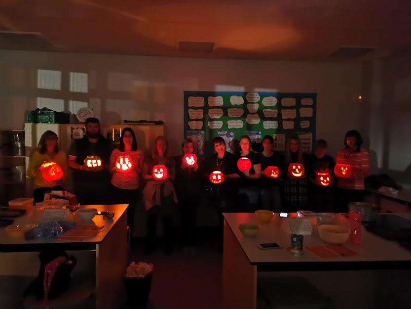 Attendees at the BYOPumpkin event show off their illuminated pumpkin creations.