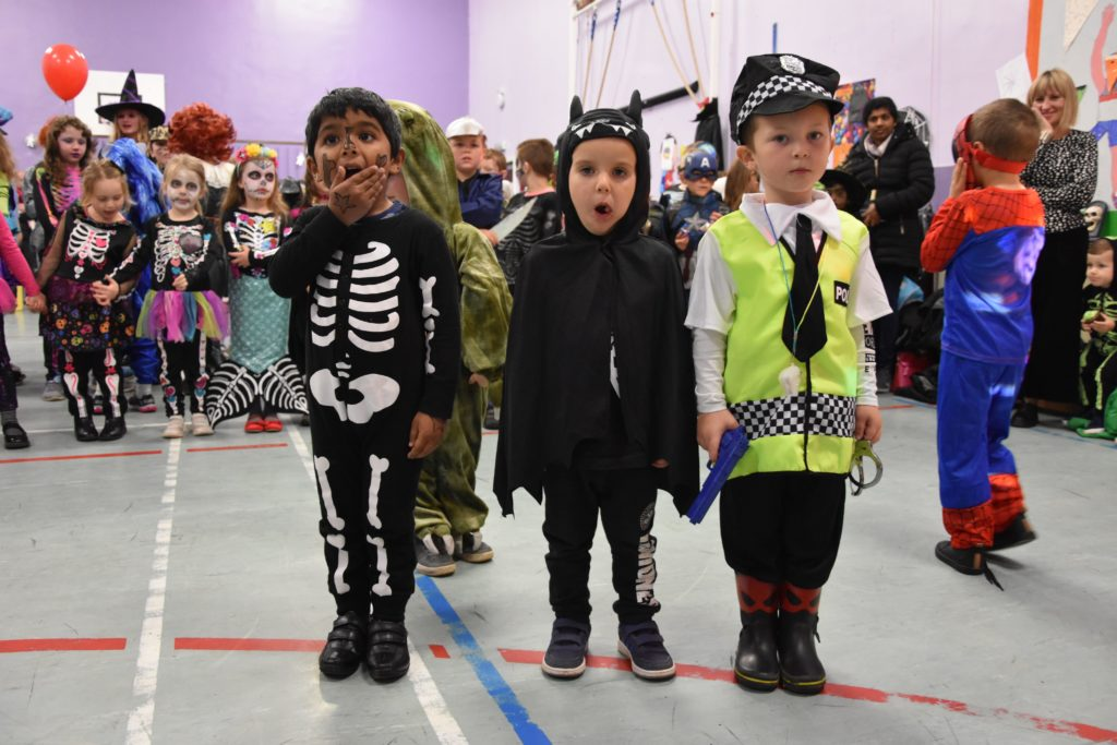 Lamlash preschool pupils dressed as a skeleton, bat-boy and a policeman.