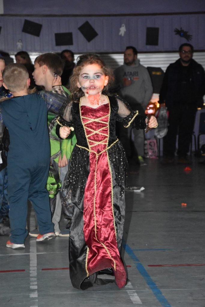 A zombie princess enjoys a snack and a dance.
