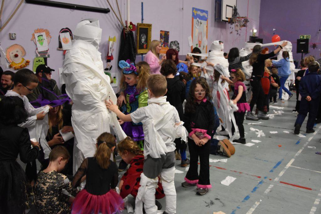 Lamlash pupils compete to wrap the best mummy.