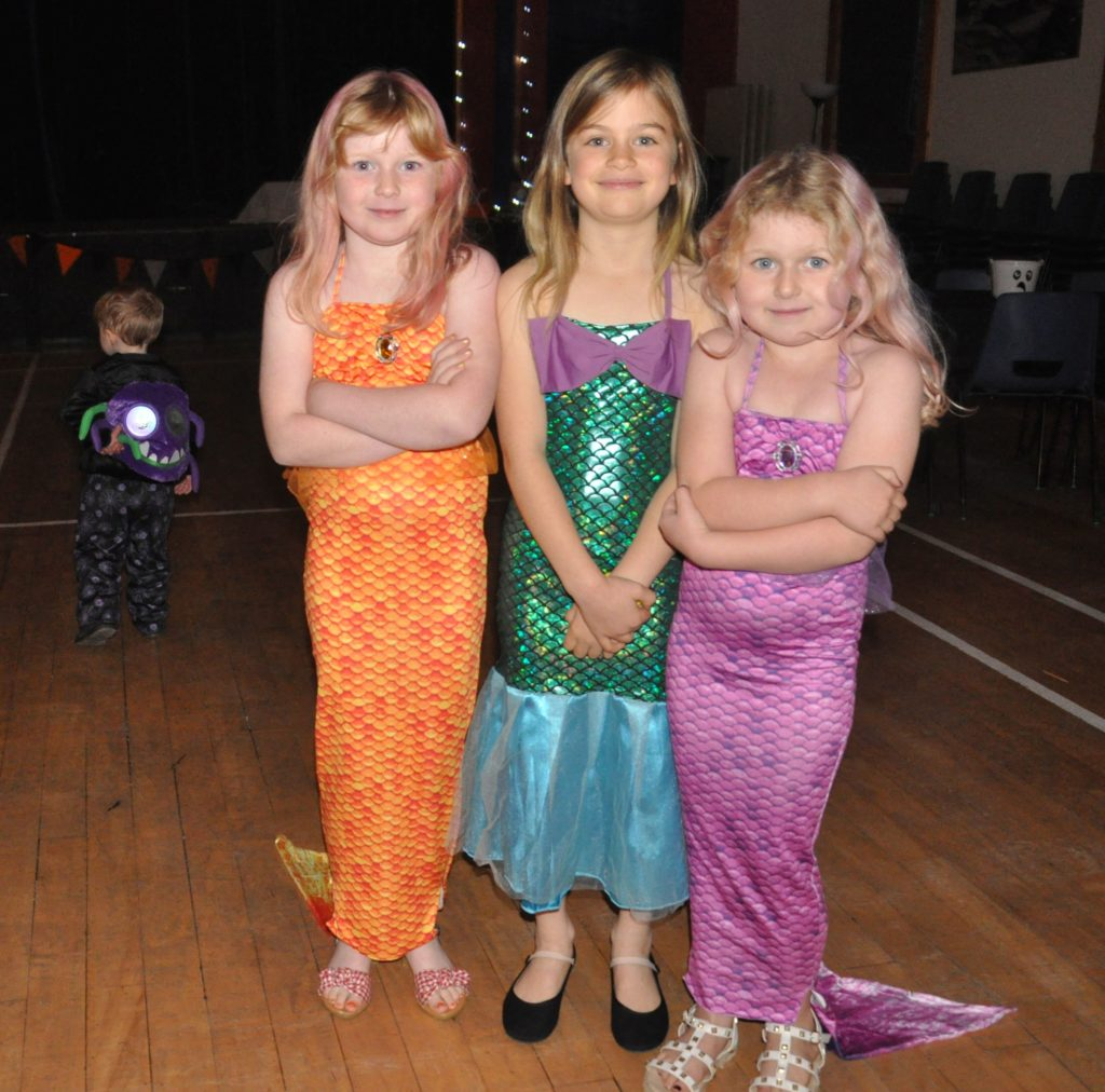 Three little mermaids look like they are feeling the cold.