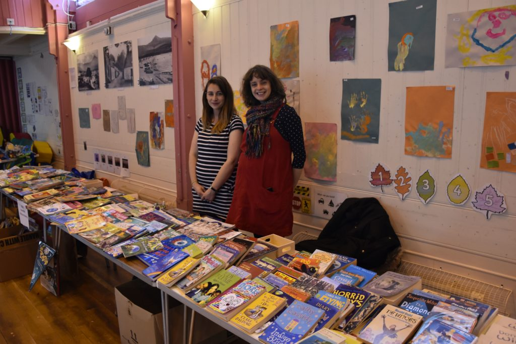 Kitty Poynter-Daltion and Claire Fleming set up their book stall in preparation for the opening.