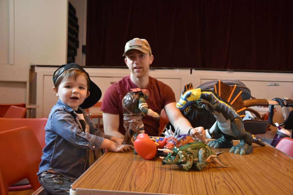 Noah McLean, with dad lain, wastes no time in playing with his new purchases.