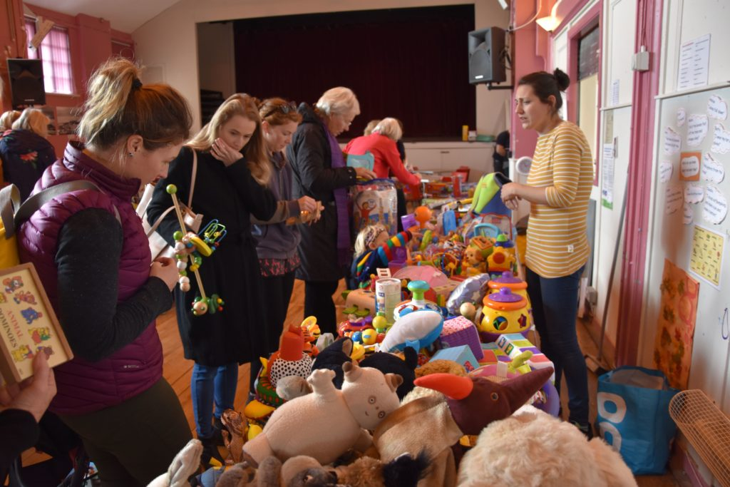 Toys galore, shoppers sift through the toys looking for their children's favourites.