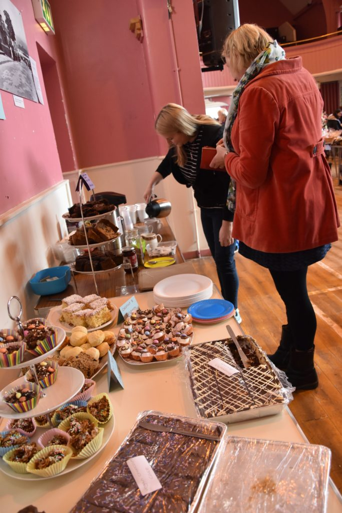 Eileen Gregg serves up tasty treats and hot drinks for visitors.