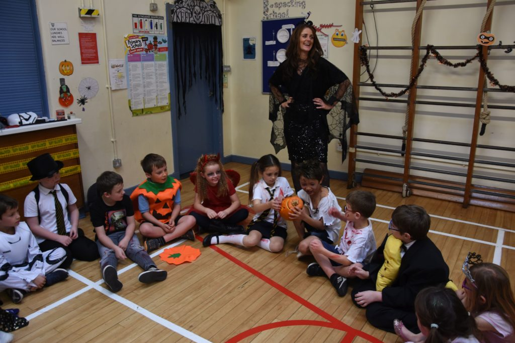 Brodick Primary pupils play pass the pumpkin.