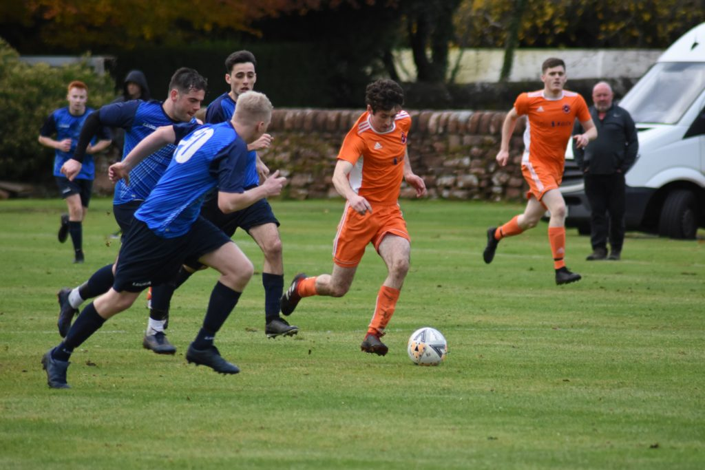 Johnny Sloss is chased by a pack of BSC players eager to deny him the ball.