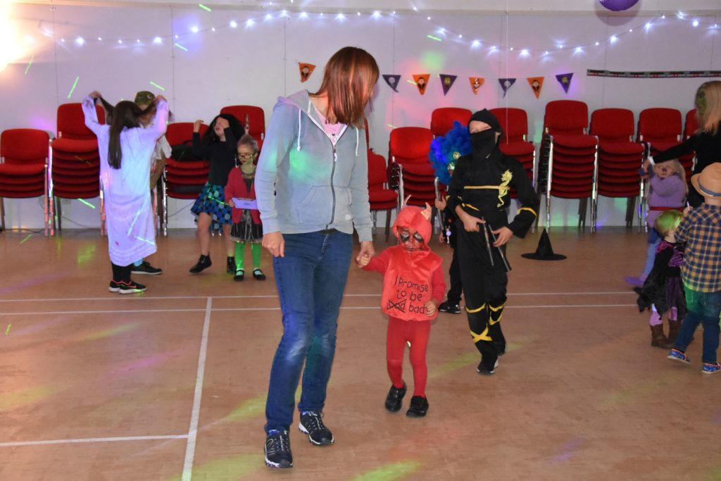 A little devil is led onto the dance floor at Lochranza.