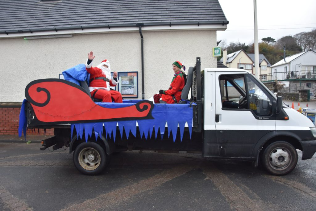 Santa and his elf are loaded onto his sleigh in preparation for the parade through the village.