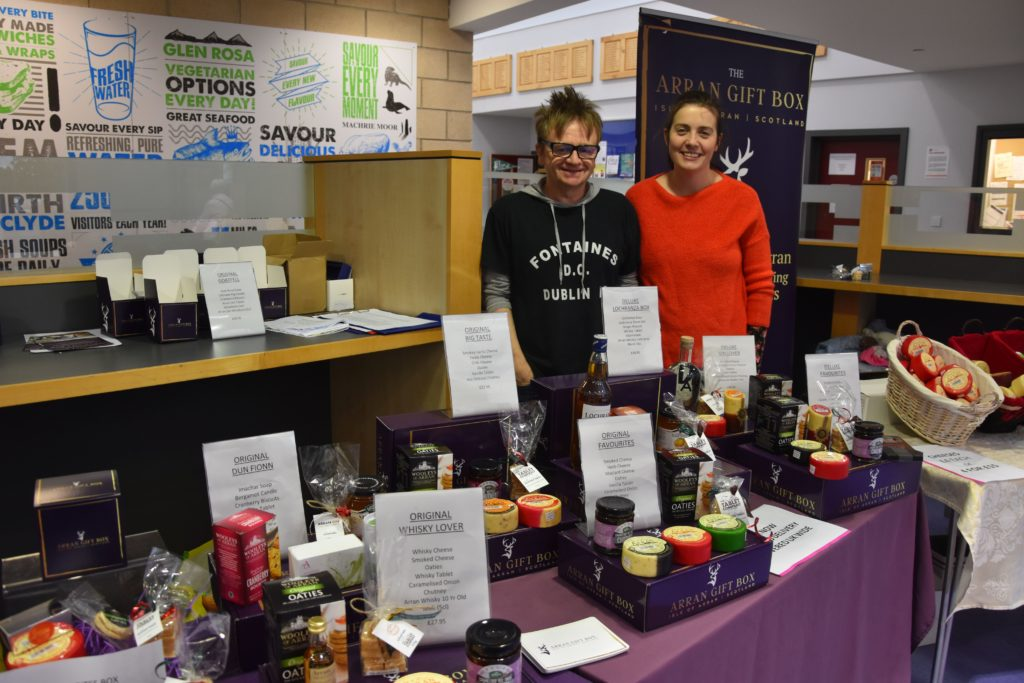 Shiona and Tom McGarrigle of the Arran Gift Box company with an extensive display of their range of popular gift boxes.