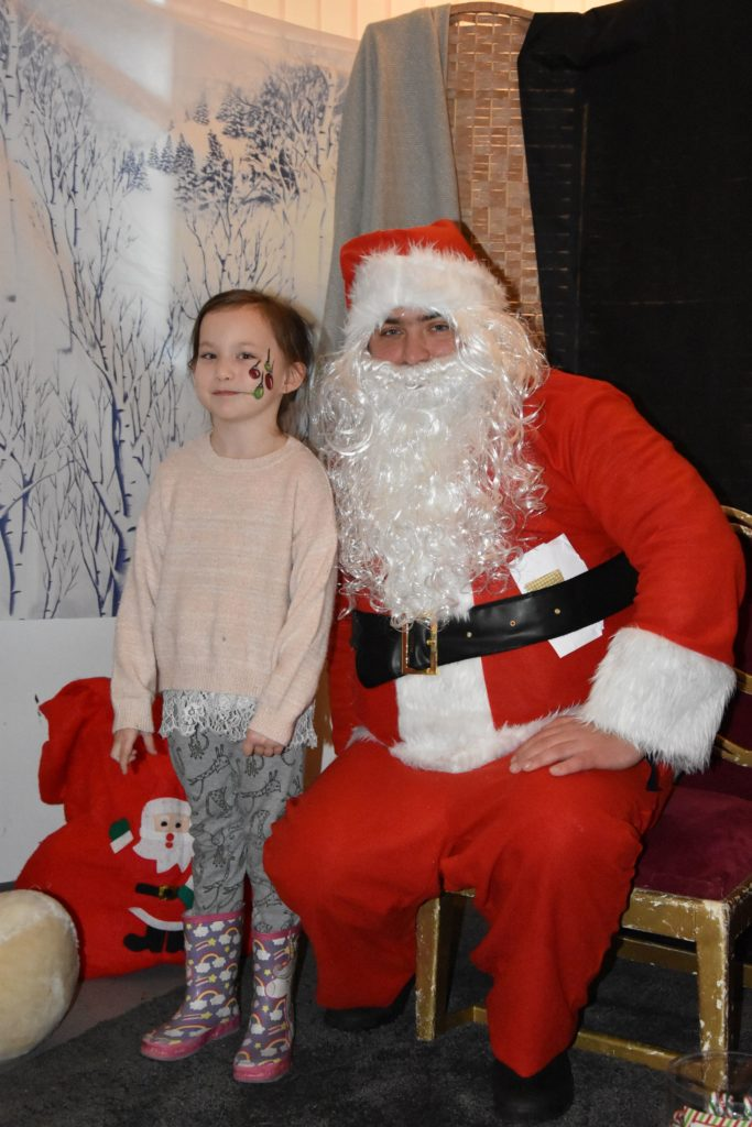 Hayley Carey is delighted and awed to be meet Santa.