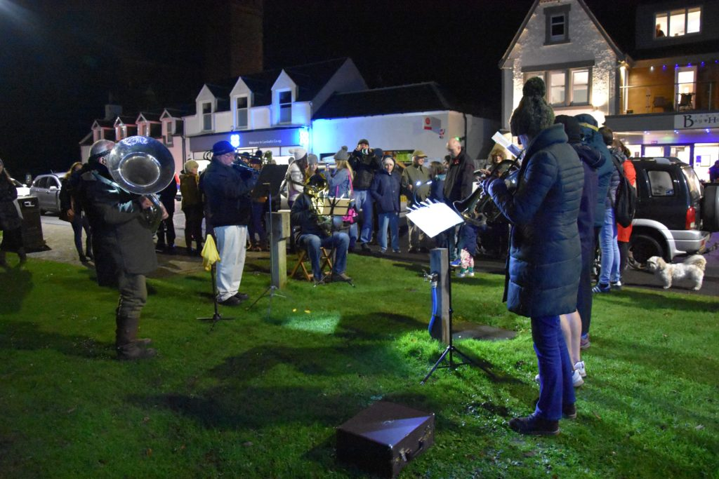 Visitors join the Arran Brass Band to sing Christmas carols.