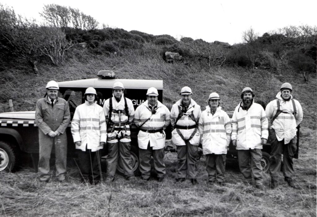 Arran's Coastguard, ready to respond, they are: Rebecca Lacey, Andy McKenzie, team leader David McKinnon, Eddie Waterland, Morag McQueen, Edward O'Donnelly and Colin Siddle. With them is sector manager David Shaw.