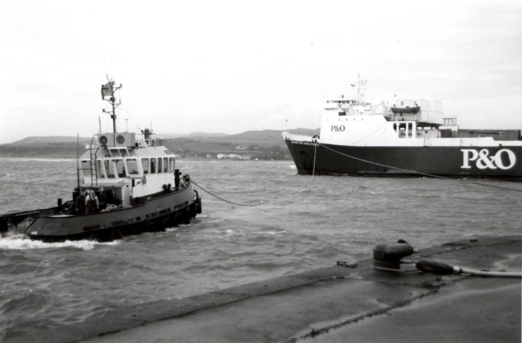 The P&O ferry European Highlander, which ran aground at Ardrossan on Wednesday, is pulled off a sandbank to clear the harbour for other shipping. MV Caledonian Isles was diverted to Gourock.