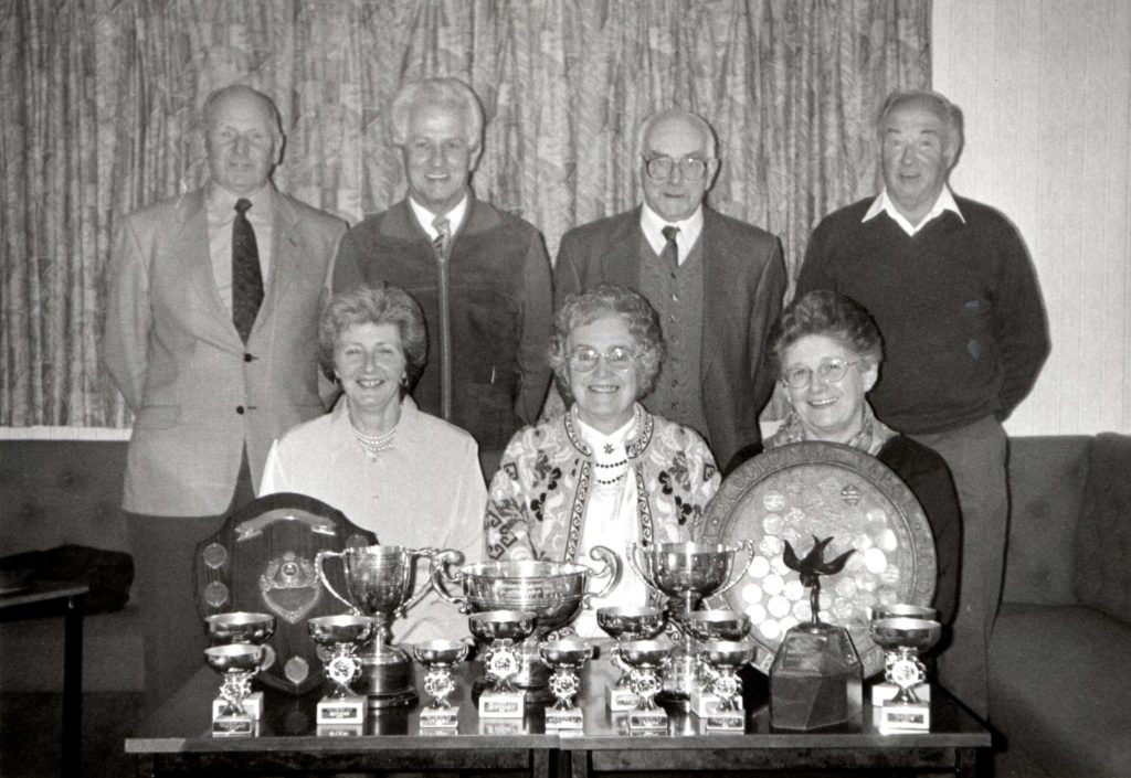 Whiting Bay Bowling Club prizewinners with a magnificent display of silverware.