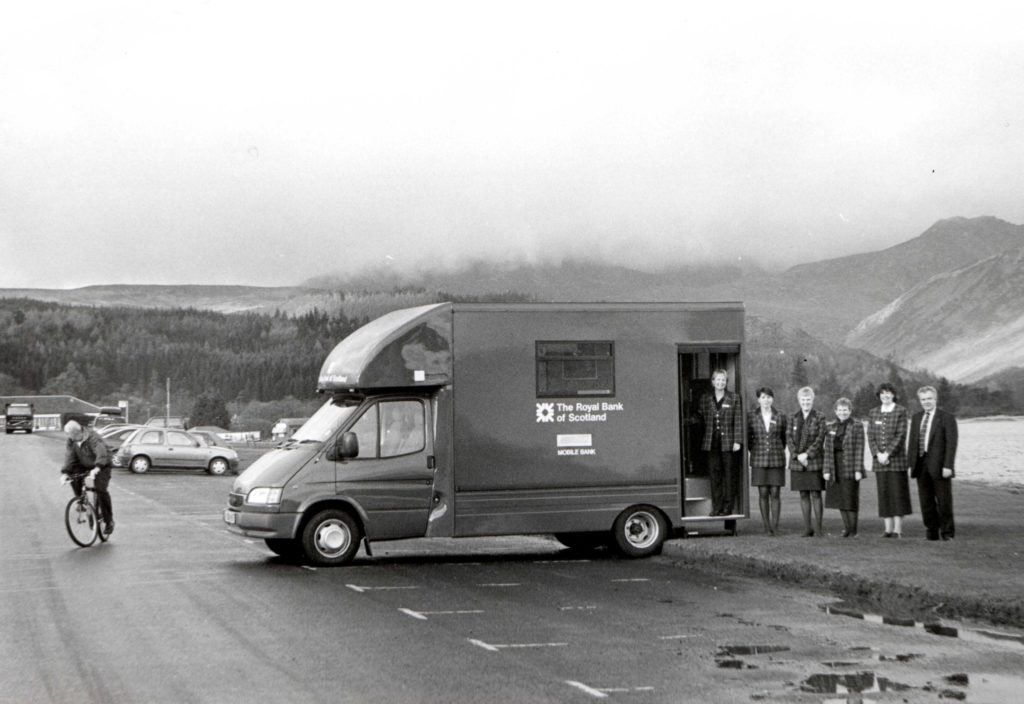 The new bank van on the front at Brodick. Those who staff her are, l to r, Alice Anderson, Moira MacAlister, Susan Murchie, Moira Chambers and Alison McNicol with driver Alan Winship.